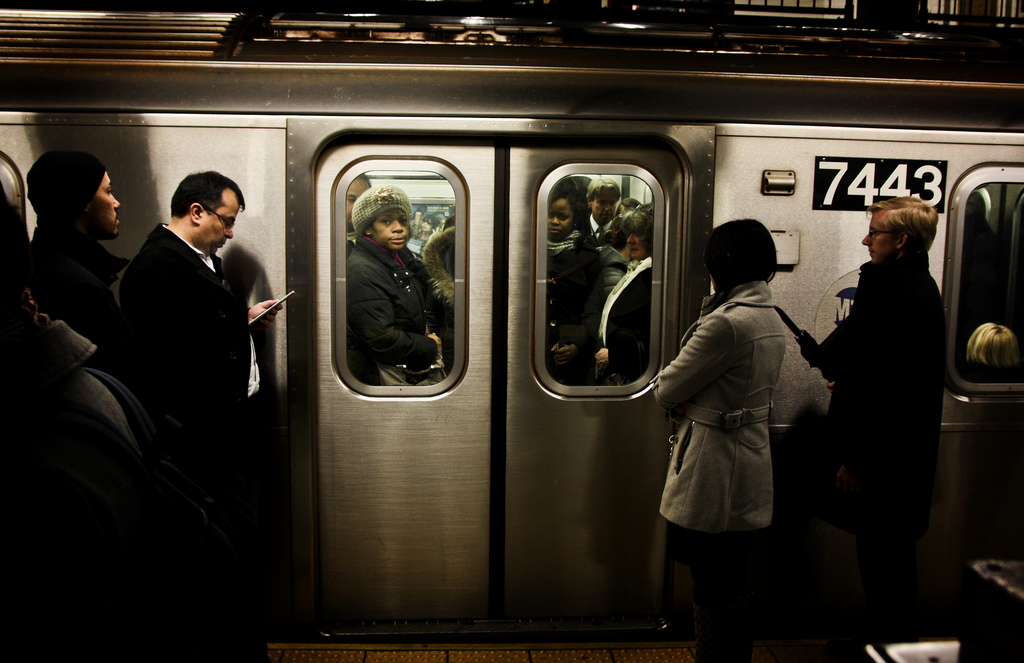 Passengers wait to board the 6 Train at Union Square during rush hour.