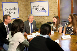 President George W. Bush participates in a roundtable on mentoring children of prisoners initiative.
