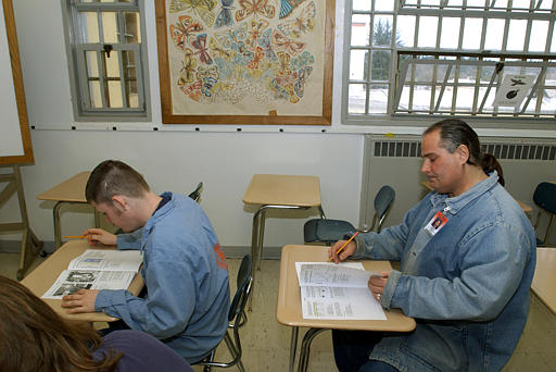 Inmates at the state penitentiary, work with General Education Diploma (GED) test materials at the prison in Salem, Ore. (AP Photo/Greg Wahl-Stephens)