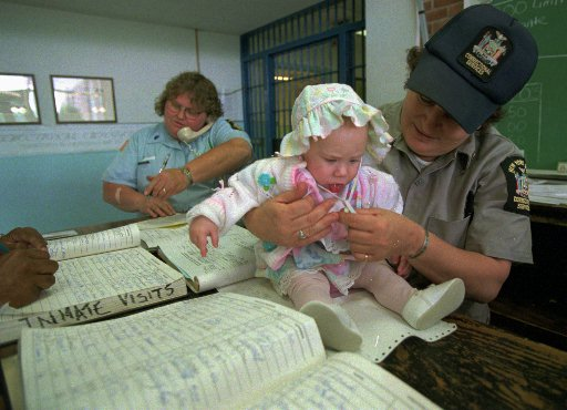 Elissa Thompson, just six months old, waits for the release of her mother, Christine Thompson, at New York's maximum-security women's prison in Bedford Hills, N.Y. (AP Photo/Kathy Willens)