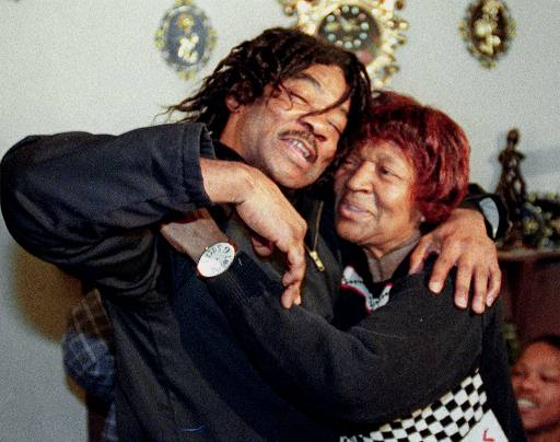 Anthony Porter was embraced by his mother Clara as they celebrated his return home in 1999. Porter was released as prosecutors investigate another man's confession to the slayings that kept Porter on death row for 16 years. (AP Photo/Mike Fisher)