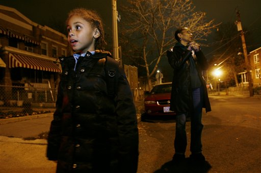 Jade, 6, left, is picked up from a friend's house by her grandmother in Washington. Jade's father, 27, has been incarcerated for possession of crack cocaine in 2004 for seven years. Easing of penalties for crack offenses could reunite thousands of families torn apart by tough drug sentences. (AP Photo/Jacquelyn Martin)