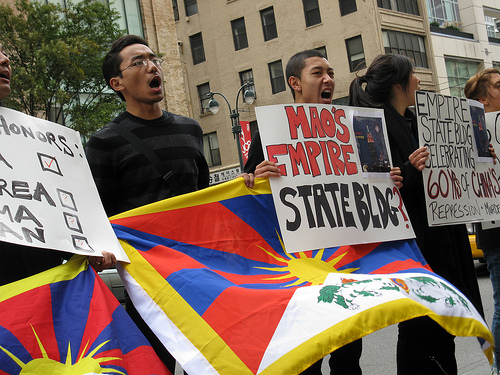 Activists displayed Tibetan flags and signs criticizing China on Fifth Avenue in front of the Empire State Building on September 30, in protest of a tower lighting ceremony to celebrate the 60th anniversary of the People's Republic of China.