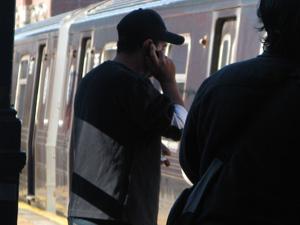 cell phone on new york subway platform astoria