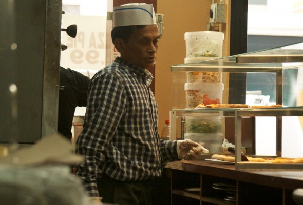 Mohid Kumar, originally from Bangladesh, manages a pizza-by-the-slice shop in Midtown, Manhattan. (Patricia Rey Mallén)