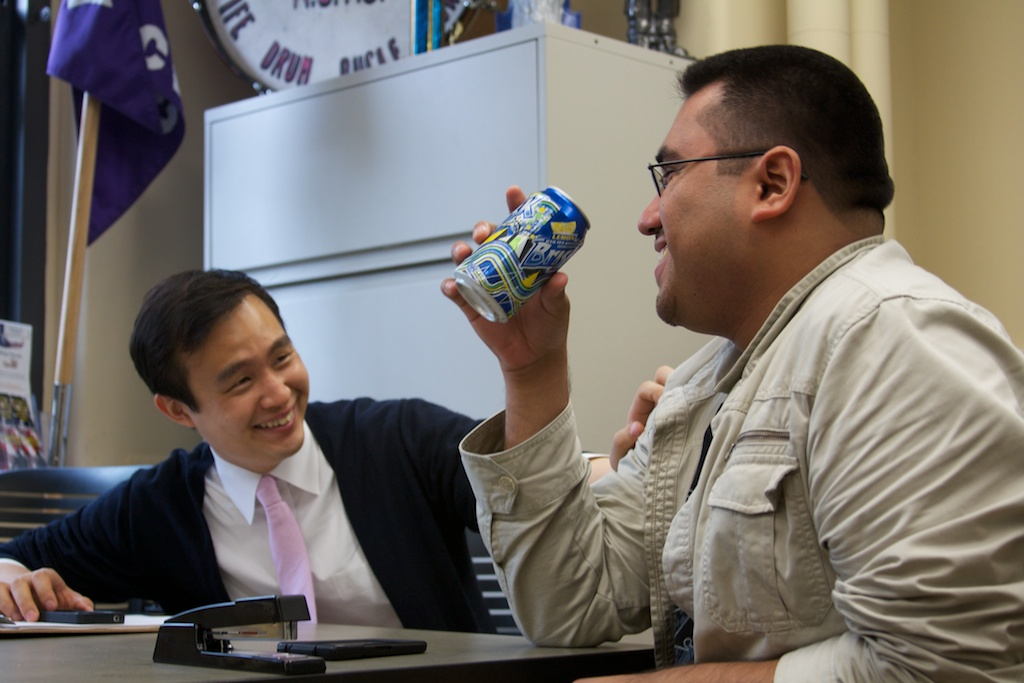 Hwang and Romero eat lunch in the Veterans Affairs office at the City College of New York.