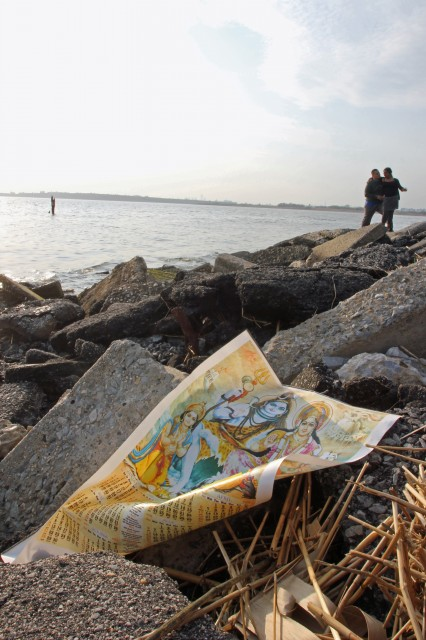 A photo of the Hindu God Shiv, lies on the rocks at Jamaica Bay