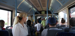 A crowded bus brings passengers from North Las Vegas to the strip