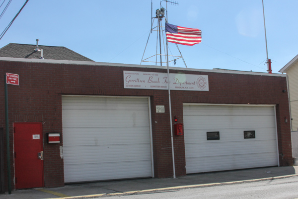 The Gerrittsen Beach Fired Department, located on Seba Avenue, is newly renovated since the inside was gutted after being flooded during Hurricane Sandy. Most times, the firehouse looks just like this – empty and closed – but when a call comes in, the volunteers rush in from their nearby homes to get to work.