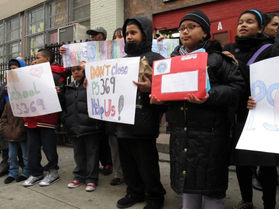 Parents, kids rally to save school