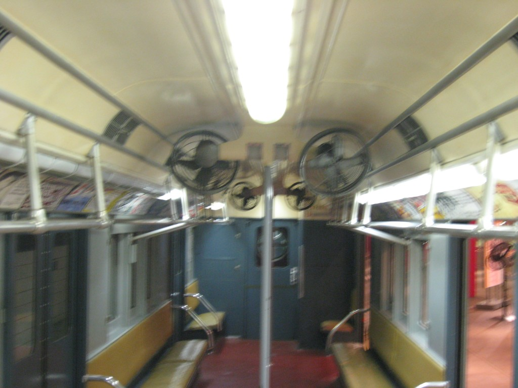 The interior of an antique subway car.