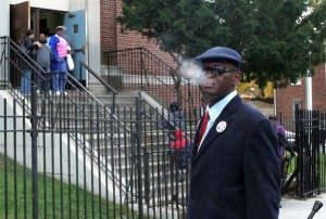Clinton Montgomery, 54, smokes a Newport in front of P.S. 118 in Hollis, Queens, after voting for the first time in three decades.